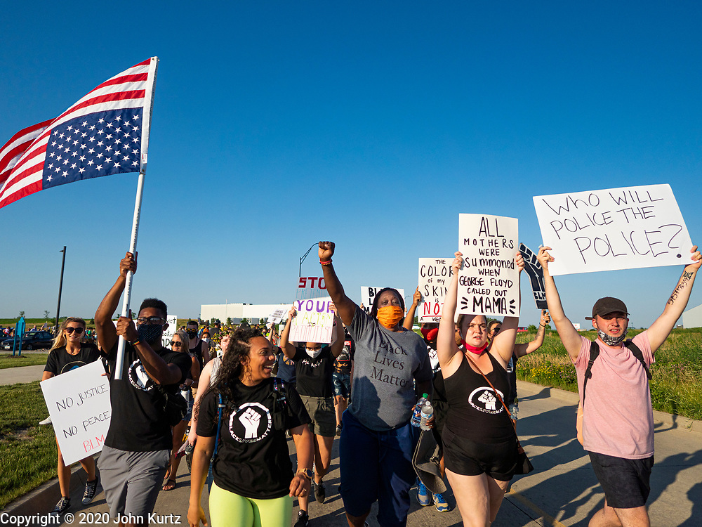 17 JUNE 2020 - NORWALK, IOWA: Members of Black Lives Matter march through Norwalk. About 400 supporters of Black Lives Matter marched through Norwalk, IA, an upper class suburb of Des Moines Wednesday. Norwalk has a population of about 10,000 and, according to the US Census Bureau, is 97 percent white. The marchers were protesting police violence against people of color. The march was a reaction to the police killing of George Floyd in Minneapolis in May. The march was peaceful.        PHOTO BY JACK KURTZ