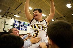 Patrick Thibodeau, senior with Downs Syndrome, started the varsity basketball game, his first, and sank a two-pointer before heading for the bench. At the end of the game Patrick subs in again, and at the buzzer sinks a three-pointer to become the hero of the night as the Greely Rangers defeat their opponent. Patrick is hoisted on the shoulders of fans and teammates.