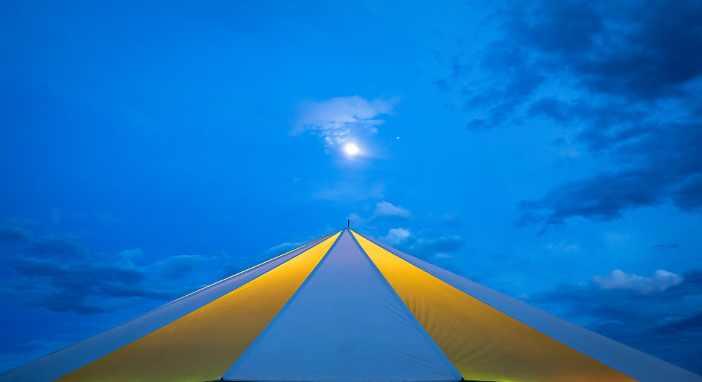 Clouds, the moon and evening star gather above one of the circus tents housing the High Mountain Hay Fever Bluegrass Festival. Presented at Art for the Sangres, double matted in an 18x28 wood frame: $475.