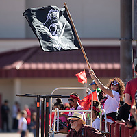 Lena Ramirez, the mother of Grants football player Xavier Ramirez waves a large Pirates flag during their game against Shiprock Chieftains, Saturday Sept. 29, 2018 in Grants.