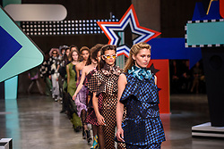 Models on the catwalk at the House of Holland Autumn/Winter 2017 London Fashion Week show at Tate Modern, London.