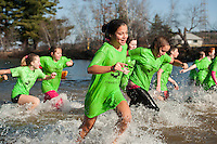 Maureen Shumway along with her teammates from Laconia Middle School's National Junior Honor Society take their dip into Opechee Cove during the 8th annual Turkey Plunge Saturday afternoon.  (Karen Bobotas/for the Laconia Daily Sun)