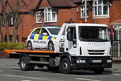 © Licensed to London News Pictures . 27/04/2016 . Manchester , UK . A police car at the scene is loaded on to a vehicle carrier and driven from the scene . Scene where police report two died in a fatal RTA involving a white Audi A5 at 03:15 this morning (Weds 27th April) . Greater Manchester Police report they observed the vehicle shortly before it crashed in to street furniture on Wilbraham Road in Chorlton, close to Whalley Range High School For Girls . Photo credit : Joel Goodman/LNP