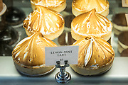 Lemon tarts among cakes and pastries on sale at Tatte Bakery and Cafe in Charles Street in historic district, Boston, USA