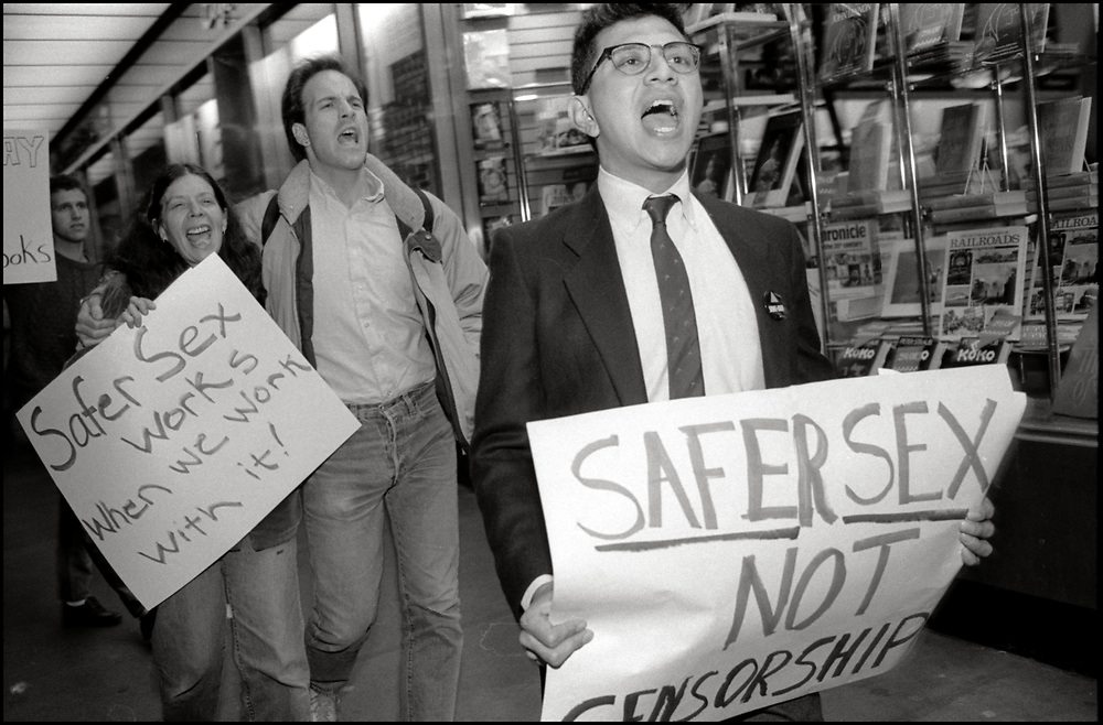 """In November of 1988, Gary Strum, Maxine Wolfe, Kaidan Erwin and Robert Garcia of ACT UP protested outside of a Waldenbooks in New York City after the chain pulled copies of the November Issue of Spin Magazine, which included a free condom inside, off of their shelves and refused to sell it. <br /> <br /> The issue featured a public service announcement that included the condom and instructions on how to use condoms.<br /> <br /> """"The condom is the magazine's way of making a statement about the deadly AIDS virus, and is telling readers to subscribe to safe sex,"""" according to a statement released by Spin editor and publisher Bob Guccione Jr."""