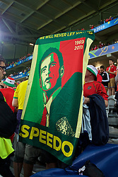 """LILLE, FRANCE - Friday, July 1, 2016: Wales supporters holds a banner """"we will never let you down Speedo"""" as they celebrate the 3-1 victory against Belgium at full time after the UEFA Euro 2016 Championship Quarter-Final match at the Stade Pierre Mauroy. (Pic by Paul Greenwood/Propaganda)"""