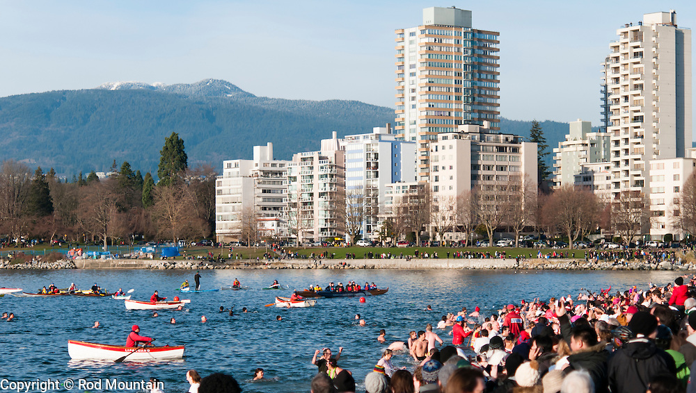 The traditional New Year's Day Polar Bear Swim at English Bay, Vancouver, BC.