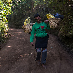 Supeno, the miner can't afford a trolley. Because the salary isn't enough to feed his family of 4 properly. He still has to carry the load of 80kg the whole way of 3km downhill. It will take him about an 2-3 hours. Trolleys cost about 2 million Rupiah (150 USD). Not all of the miners can afford one. Most of the trolleys are coming from donations.