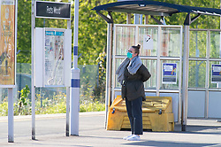 ©Licensed to London News Pictures 14/05/2020<br /> Petts Wood, UK. A lone commuter wearing a protective mask on an empty platform. Only a handful of London commuters at Petts Wood train station in Petts Wood, South East London this morning due to the on going threat of Coronavirus. Photo credit: Grant Falvey/LNP