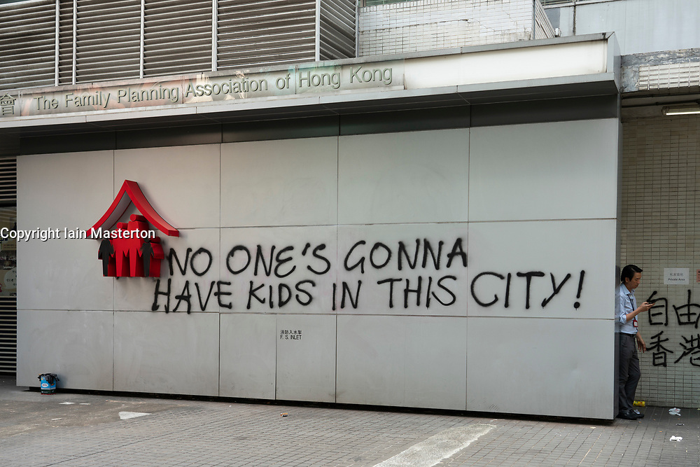 Hong Kong. 2 October 2019.  Many buildings and walls were vandalised and daubed with political slogans and anti-Chinese government and anti-police graffiti in Central and Wanchai districts by pro-democracy supporters on China's National Day on 1 October. Widespread clean-up operation is now underway. Graffiti on Family planning office building.  Iain Masterton/Alamy Live News.