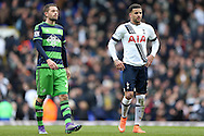Gylfi Sigurdsson of Swansea City  (l) looks dejected after the final whistle with Kyle Walker of Tottenham Hotspur. Barclays Premier league match, Tottenham Hotspur v Swansea city at White Hart Lane in London on Sunday 28th February 2016.<br /> pic by John Patrick Fletcher, Andrew Orchard sports photography.