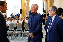 French president Emmanuel Macron awards French football Federation president Noel Le Graet and French national football team head coach Didier Deschamps during a Legion of Honour award ceremony for French 2018 football World Cup winners at the Elysee Palace in Paris, on June 4, 2019. Photo by Hamilton/pool/ABACAPRESS.COM