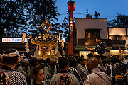 Mikoshi are carried around the streets of Asakusa, on the evening of the first day of the Sanja matsuri. Asakusa, Tokyo, Japan. Friday May 13th 2016 The Sanja matsuri is one of the biggest festivals in Japan. Taking place over the 3 days of the second weekend of May (May 13th to 15th) it features many mikoshi, or portable shrines, that are carried around by local groups to bring blessings and prosperity to their neighbourhoods