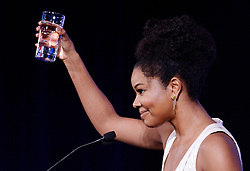 Actress Gabrielle Union raises a glass of water during the Healthier America's 2017 summit on May 12, 2017 at the Renaissance hotel in Washington, DC. Photo by Olivier Douliery/ Abaca