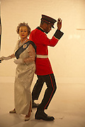 CORINNE AS THE QUEEN; JASPER, filming for Sly and Reggie ' Dub Save the Queen. Moorish Rd. London Sw2. 5 April 2012.