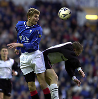 Rangers v  Motherwell, Scottish Premier Division.<br />Ibrox Park.       Pic Ian Stewart, December 10th. 2000.<br /><br />Tore Andre Flo heads past Steven Hammell