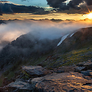 High above the clouds for a misty alpine sunset at Rock Cut Overlook in Rocky Mountain National Park, Colorado