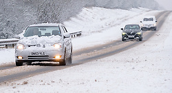 © Licensed to London News Pictures 24/01/2021, Cirencester, UK. Hazardous driving conditions after heavy overnight snow on the A417, outside cirencester. Photo Credit : Stephen Shepherd/LNP
