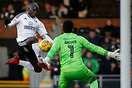 Neeskens Kebano of Fulham (L) has a shot at goal from close range saved by Jordan Archer , the goalkeeper of Millwall (R). EFL Skybet football league championship match, Fulham v Millwall at Craven Cottage in London on Saturday 25th November 2017.<br /> pic by Steffan Bowen, Andrew Orchard sports photography.