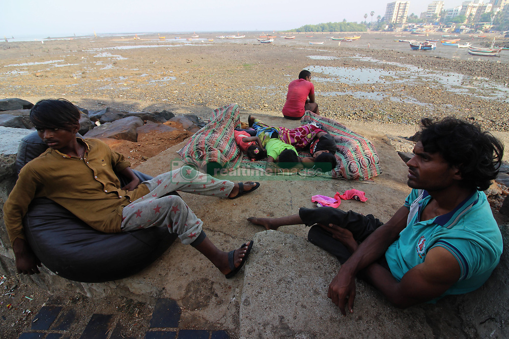 March 26, 2019 - Mumbai, India - People sleep by the seaside in Mumbai, India on 26 March 2019. According to human rights groups, more than four million homeless people in the country are likely to be barred from voting in India's elections because of biases and difficulties in getting identification papers, despite efforts by authorities to get them registered. (Credit Image: © Himanshu Bhatt/NurPhoto via ZUMA Press)