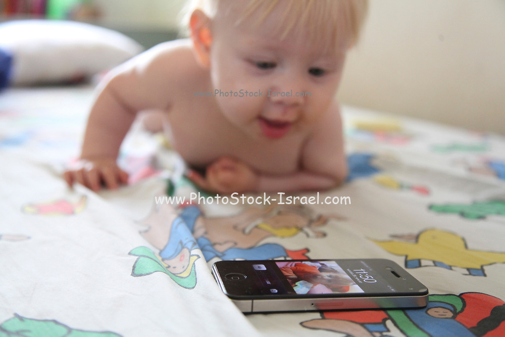 A Baby plays with a smart phone