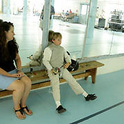 Kelly Godbey, left sits with her son Gerrit Swart, 9, after a Cape Fear Fencing Association youth fencing tournament at Tileston Gym in Wilmington, N.C. Saturday May 31, 2014. (Jason A. Frizzelle)