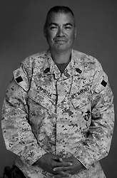 1st Sgt. Steven Espinosa, 40, Modesto, California, Kilo Company, 3rd Battalion, 1st Marine Regiment, 1st Marine Division, United States Marine Corps, at the company's firm base in Hit, Iraq on Friday Sept. 23, 2005.