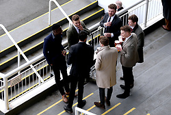 Racegoers enjoy the atmosphere during the Easter Family Fun Day at Kempton Park Racecourse.