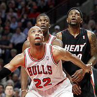 14 March 2012: Chicago Bulls forward Taj Gibson (22) vies for the rebound with Miami Heat power forward Udonis Haslem (40) during the Chicago Bulls 106-102 victory over the Miami Heat at the United Center, Chicago, Illinois, USA.