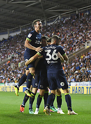 Derby County's Mason Mount (obscured) celebrates scoring his side's first goal of the game with team-mates
