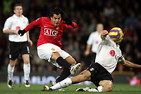 Photo: Paul Thomas/Sportsbeat Images.<br /> Manchester United v Fulham. The FA Barclays Premiership. 03/12/2007.<br /> <br /> Carlos Tevez of Man Utd shoots at goal past Aaron Hughes (R).