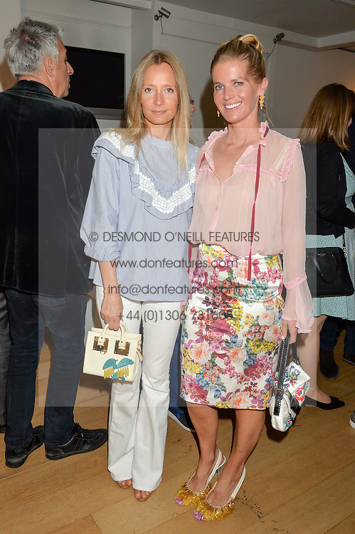 Left to right, MARTHA WARD and COUNTESS ALEXANDRA TOLSTOY at a private view of photographs by Jolyon Fenwick 'The Zero Hours Panoramas' 100 Years On: Views From The Parapet of The Somme held at Sladmore Contemporary, 32 Bruton Place, London on 30th June 2016.
