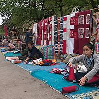 Women selling their wares along a main street in Luang Prabang.