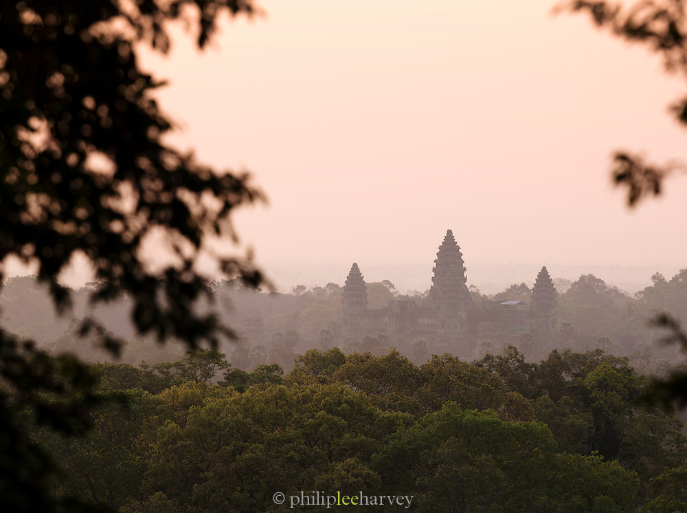 The spires of Angkor Wat tower above the surrounding forest, Siem Reap Province, Cambodia