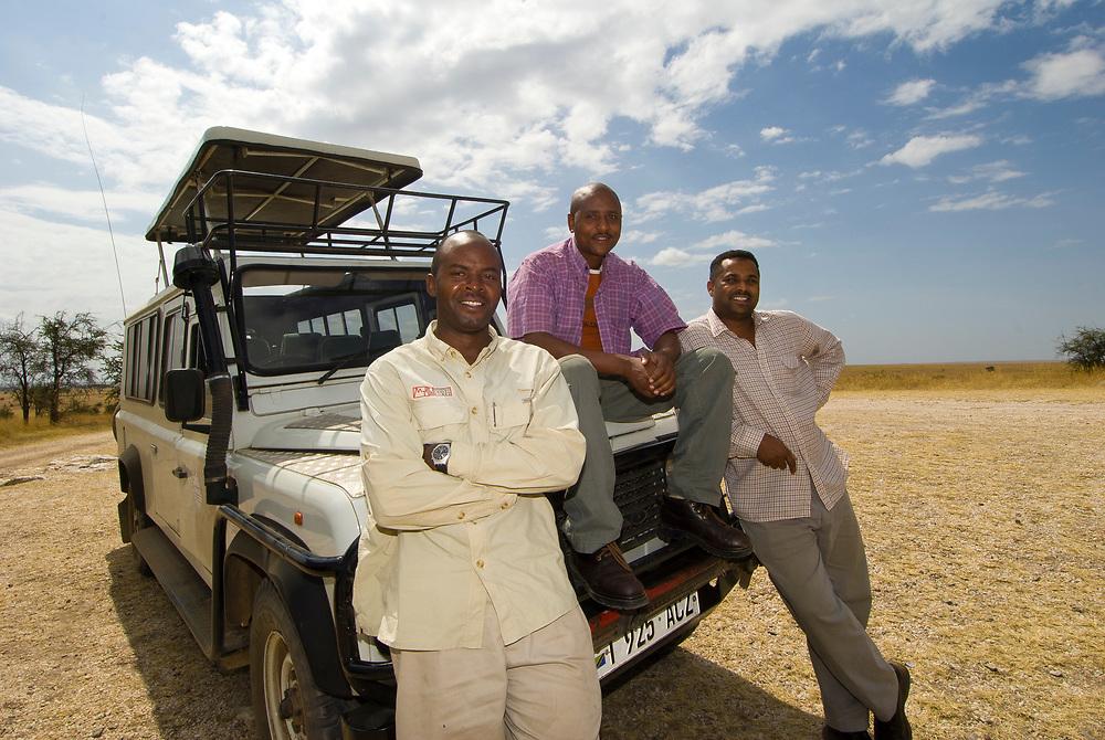 Mountain Travel Sobek tour guides Simon Mungai (left), Leonard Alfayo and Remtulla Abdul, Serengeti National Park, Tanzania