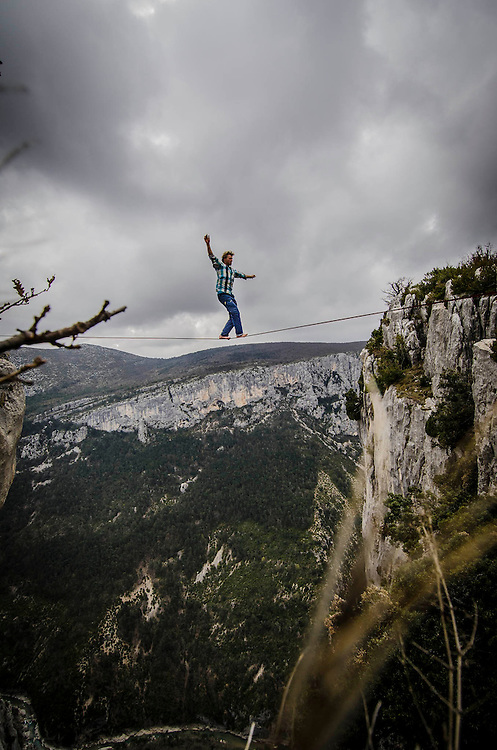Mich Kemeter is not only an extremely talented climber as well as he performs equally good as an Highliner or BASE jumper. Here, warming up with a freesolo (no safety leash or harness) on one of the Verdon gorge's Highlines during the International Highline meeting in April 2012. Following his warm up Mich climbed in freesolo a cliff 1000ft above the beautiful river of Verdon.
