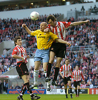 Photo. Glyn Thomas, Digitalsport<br /> NORWAY ONLY<br /> <br /> Sunderland v Crystal Palace. <br /> Division 1 Playoffs, second leg. 17/05/2004.<br /> Sunderland's Gary Breen (R) fights an aerial battle for possession with Palace's Andrew Johnston.