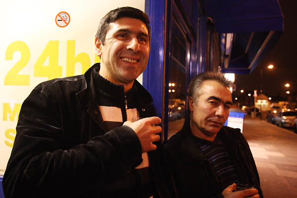 Hassan (left) with Cebrail Polat.Drivers at Circle Cars, Turnpike Lane N8.Country of birth: Turkey..