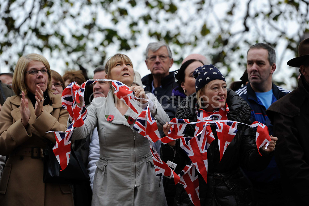 Crowds with union jack bunting gather at the Lord Mayor's Show in London.