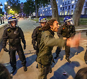 A protestor tries to calm his fellow protestors during clashes with police in central London on Wednesday, June 3, 2020. (Photo/ Vudi Xhymshiti)