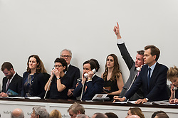 © Licensed to London News Pictures. 03/03/2016. London, UK.  Sotheby's staff make bids on behalf of telephone clients at Sotheby's Impressionist, Modern & Surrealist art evening sales in New Bond Street.  The combined total of the sale was forecast to realise between £97-138m. Photo credit : Stephen Chung/LNP