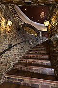 Castle like staircase in large home. Photo by Brandon Alms Photography