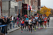 The leading group of male runners is pictured as they approach 4th Ave on 92nd St in the New York City Marathon on 4th Ave in Brooklyn, NY on Sunday, Nov. 3, 2013.<br /> <br /> CREDIT: Andrew Hinderaker for The Wall Street Journal<br /> SLUG: NYSTANDALONE