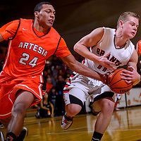 010815       Cable Hoover<br /> <br /> Artesia Bulldog Travis Wilkinson (24) attempts to steal the ball from Grants Pirate Keegan Stewart (11) during the Gallup Boys Invitational at Gallup High School Thursday.