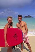 Couple on Lanikai Beach, Oahu, Hawaii<br />