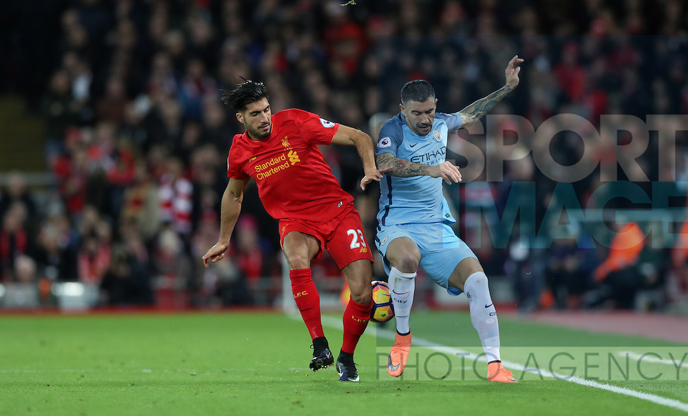 Emre Can of Liverpool and Aleksandar Kolarov of Manchester City during the English Premier League match at Anfield Stadium, Liverpool. Picture date: December 31st, 2016. Photo credit should read: Lynne Cameron/Sportimage