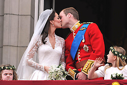 File photo dated 29/04/11 of Prince William and his wife Kate Middleton kissing on the balcony of Buckingham Palace, London, following their wedding at Westminster Abbey. The Duchess of Cambridge will have spent a decade as an HRH when she and the Duke of Cambridge mark their 10th wedding anniversary on Thursday. Issue date: Wednesday April 28, 2021.