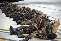 Members of the Parachute regiment await embarking a RAF C130 Hercules aircraft from which they will parachute from in a training exercise. May 1990 photograph by Terry Fincher
