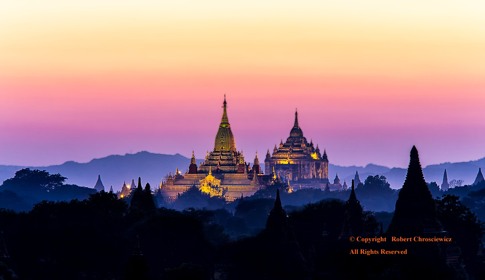 Bagan Sunset: A kaleidoscope of colours grace the sky as sunset descends over the holiest of temples in Bagan Myanmar.