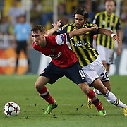 Fenerbahce's Alper Potuk and Arsenal's Ramsey during the UEFA Champions League Play-Offs First leg soccer match Fenerbahce between Arsenal at Sukru Saracaoglu stadium in Istanbul Turkey on Wednesday 21 August 2013. Photo by Aykut AKICI/TURKPIX